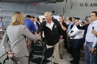 Image: President Donald Trump arrives at Luis Muniz Air National Guard Base