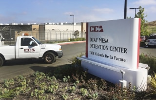 Image: A vehicle drives into the Otay Mesa detention center in San Diego