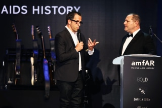 Image: Kenneth Cole, amfAR chairman, and Harvey Weinstein speak on stage at the amfAR's 20th Annual Cinema Against AIDS