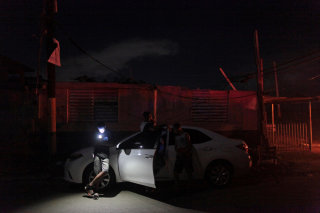 Image: People try to use their mobile phones after Hurricane Maria hit the island and damaged the power grid in Dorado