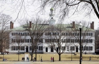Image: Students walk across the Dartmouth College campus green in Hanover