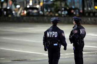 Image: Police look towards the scene of a pickup truck attack on West Side Highway in Manhattan, New York