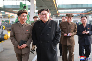 Image: North Korean leader Kim Jong Un visits a factory in this undated picture provided by KCNA in Pyongyang