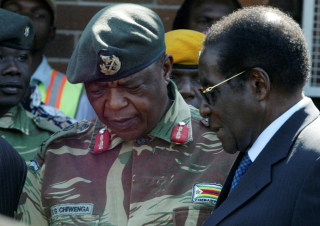 Image: Zimbabwe's leader Robert Mugabe, pictured in 2008 talking to military general Constantino Chiwenga.