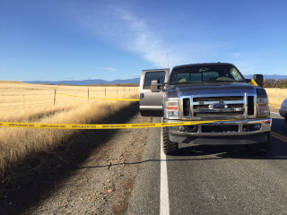 Image: Rancho Tehama Road completely blocked off by crime tape after reported shootings at Rancho Tehama Elementary School in California.