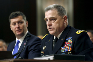 Image: Milley testifies at the Senate hearing about women deployed in ground combat units on Capitol Hill  in Washington