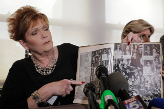 Image: Accuser Beverly Young Nelson points to a photograph of herself in her high school yearbook after making a statement claiming that Alabama senate candidate Roy Moore sexually harassed her when she was 16, in New York