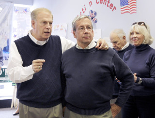 Image: Former Ohio Gov. Ted Strickland, left, talks with Bill O'Neill