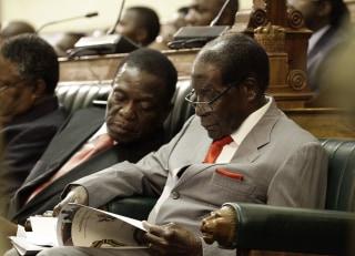 Image: Emmerson Mnangagwa and Robert Mugabe
