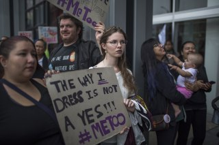 Image: Demonstrators participate in the #MeToo march in response to high-profile sexual harassment scandals