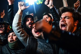 Image: Protesters chant against America outside the U.S. Consulate in Istanbul Wednesday night.