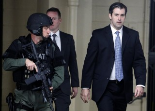 Image: Michael Slager walks from the Charleston County Courthouse under the protection from the Charleston County Sheriff's Department