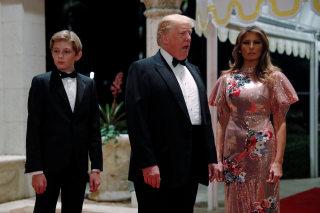 Image: Barron Trump, Donald Trump and Melania Trump