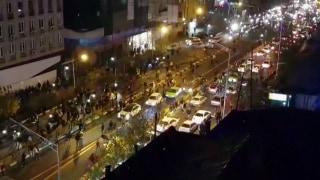 Image: Men walk down a street in Tehran, Iran, on Dec. 30, 2017
