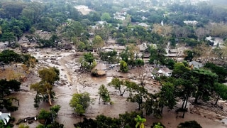 Image: Mudflow and damage from mudslides are pictured in this aerial photo taken from a Santa Barbara County Air Support Unit Fire Copter over Montecito