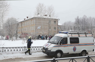 Image: An emergency vehicle outside the school in Perm, Russia