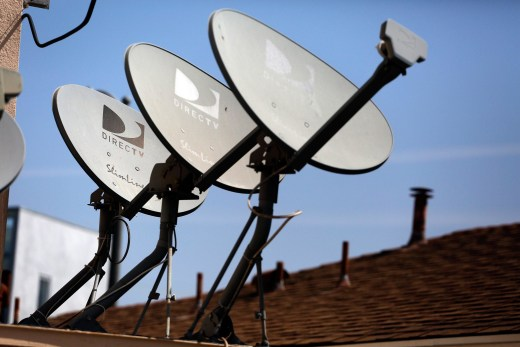 Image: DirecTV satellite dishes sit atop an apartment roof in Los Angeles, Calif.