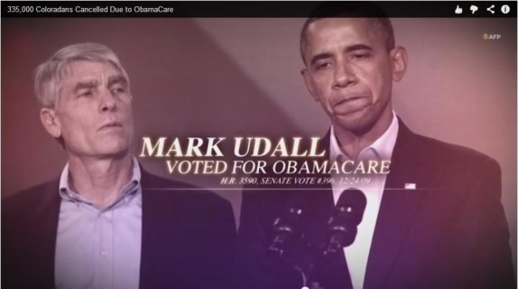 Koch brothers-backed group use misleading Aurora shootings related photo in political ad
