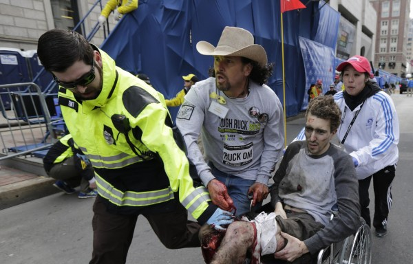 Image: Bombing victim Jeff Bauman is rushed to medical help