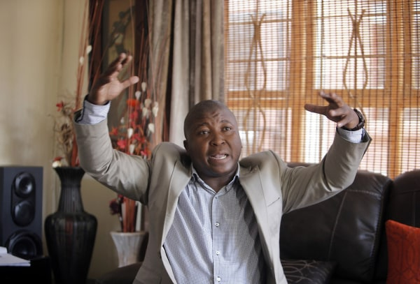 Image: Thamsanqa Jantjie gesticulates at his home during an interview on Thursday.