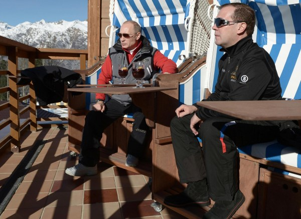 "Image: Russian President Putin and PM Medvedev chat during their visit to the ""Laura"" cross country ski and biathlon centre in the resort of Krasnaya Polyana near Sochi"