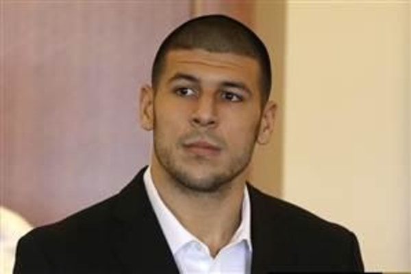 Image: Aaron Hernandez, formerly of the New England Patriots, stands during his arraignment in Fall River, Mass., on Sept. 6.