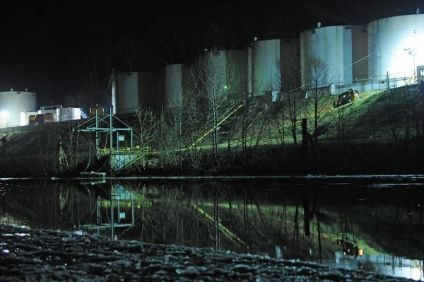 Image: Crews clean up a chemical spill along the Elk River in Charleston, W.Va.