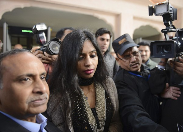Image: Indian diplomat Khobragade leaves with her father to meet India's Foreign Minister Salman Khurshid in New Delhi