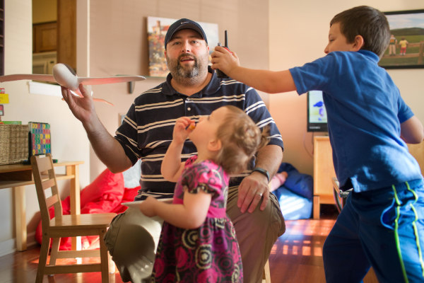 Image: Brad Chaffee plays with his children at home in Charlottesville, Va.