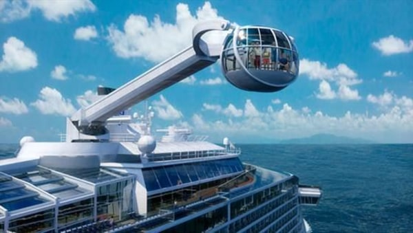 Image: In this artist's rendition, the North Star capsule swings up and out over the ocean from the top deck of Royal Caribbean's Quantum of the Seas, which will launch in November.
