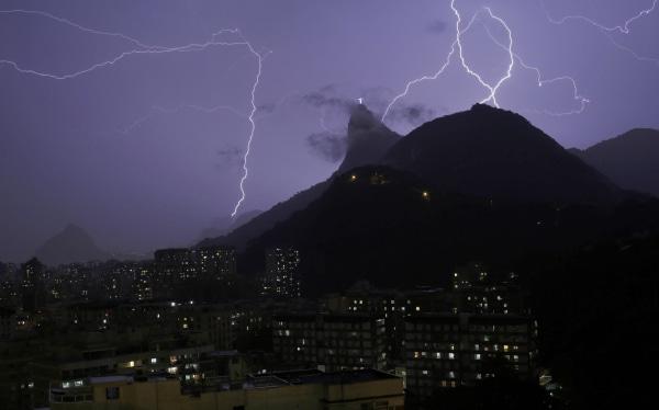 Image: Lightning bolts strike through the sky near Christ the Redeemer statue in Rio de Janeiro