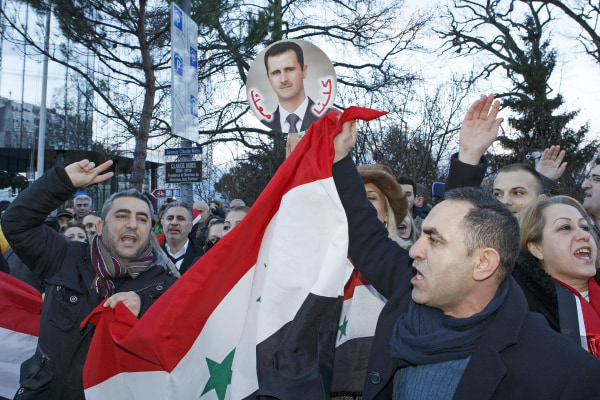 Image: Demonstrators support Syrian President Bashar Assad as they protest Wednesday near the venue of the of peace talks in Montreux, Switzerland.