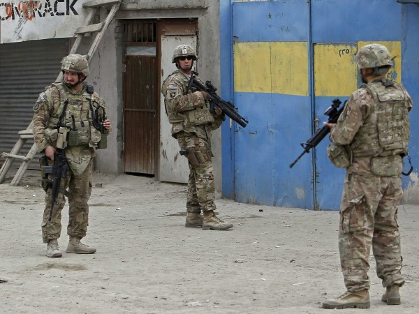 Image: U.S. troops inspect the site of a bomb attack in Kabul on Dec. 27, 2013.