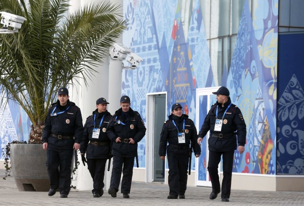 Image: Security guards patrol at the Olympic Park in Adler near Sochi