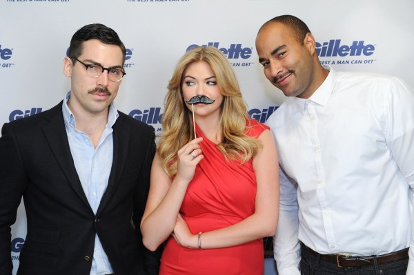 Kate Upton poses with two mustachioed men for a Team Gillette event to support Movember efforts to raise funds and awareness for men's health issues.