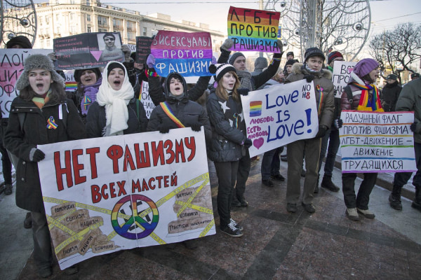 Image: Russian gay rights activists march along a Moscow boulevard on Jan. 19, 2014.