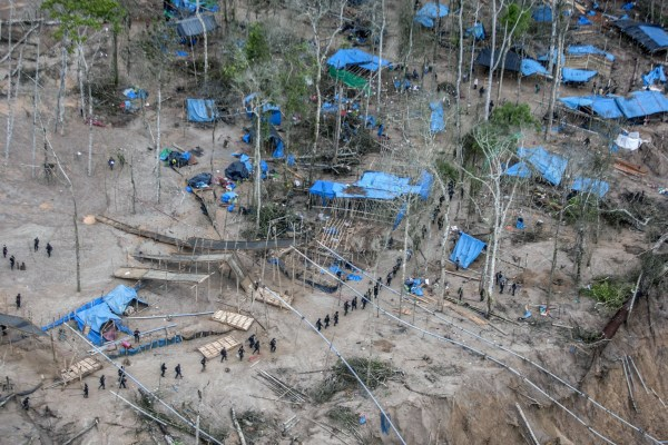 Image: View of camps surrounding pumps used for illegal gold mining
