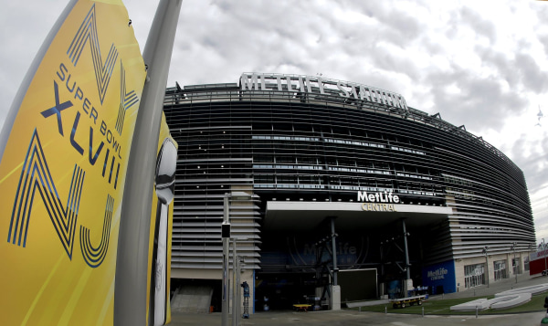 Prices are dropping for tickets to the big game on Sunday. A banner is seen outside MetLife Stadium in East Rutherford, N.J.