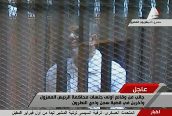 Image: Deposed Egyptian president Mohamed Morsi in the accused cage in a makeshift courtroom