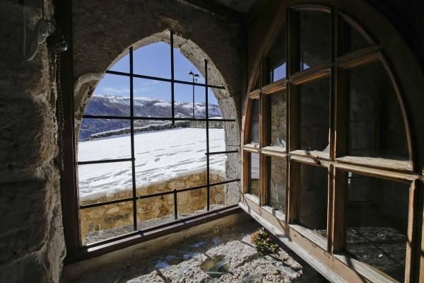 Image: A broken window is seen in the small mountain church of San Pietro della Ienca, near the city of L'Aquila