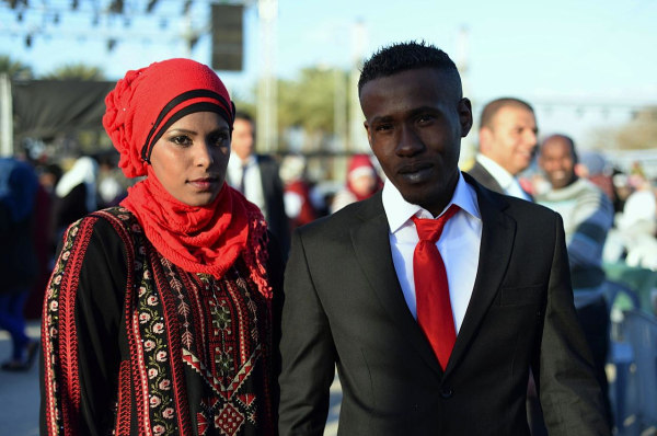 Amina Mohammed Saed, 24, with her new husband Ala'a Obeid, also 24.