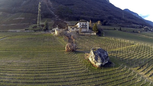 Image:  a huge boulder is seen after it missed a farm house