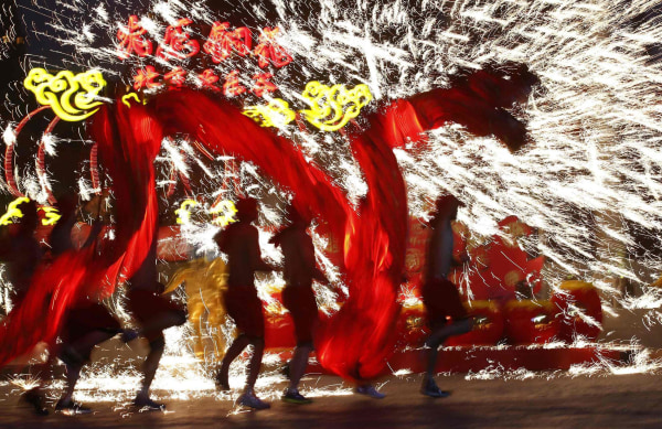 Image: Dancers perform during a folk art performance in Beijing