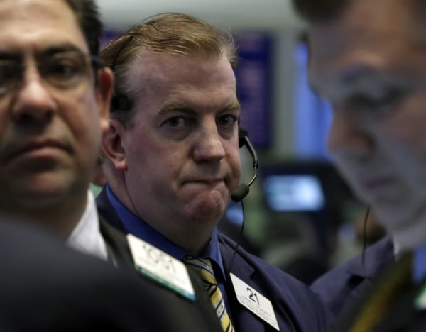 Gloomy view: Traders on the floor of the New York Stock Exchange Friday where the Dow dropped 149 points for its first losing month since August.