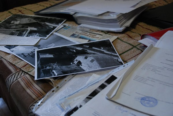 Image: Lumdilla Savelyeva's old house is shown on photos among court and property documents.