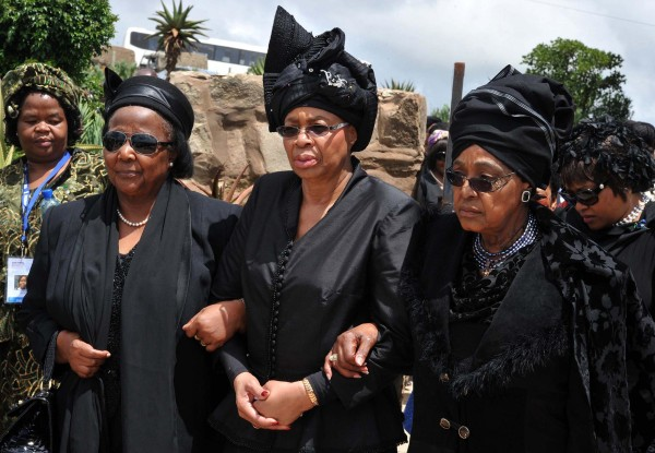 Image: The widow of Nelson Mandela, Graca Machel (C), and his ex-wife Winnie Mandela Madikizela (R)