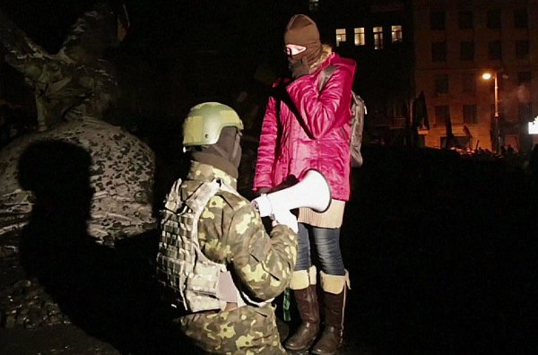 Image: A protester proposing to his girlfriend in a street close to Kiev's Independence Square