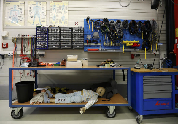 Image: A dummy is prepared for a car crash-test at the laboratory of the German motor club ADAC in Landsberg