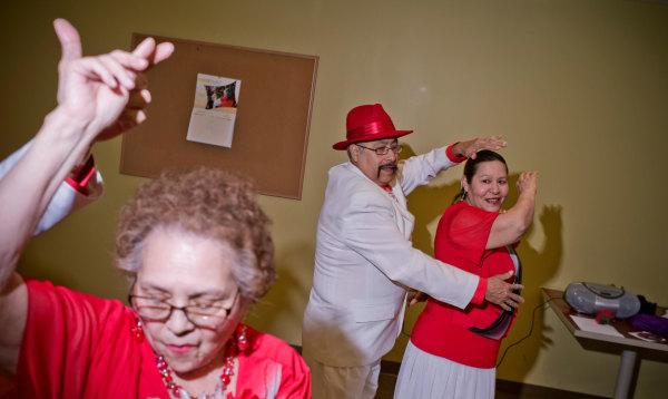 Image: Consuelo Martinez, left,  Eloy Guerrero, center, and Gloria Barrios, members of the group Los Danzonera Pilsen, perform at Casa Maravilla in Chicago.