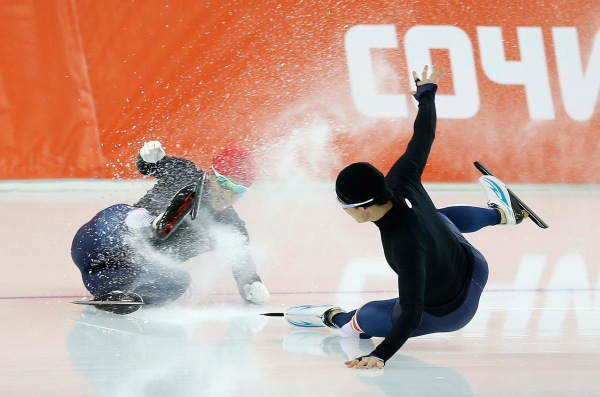 Image: Kim Jun Ho of South Korea crashes during practice at the Adler Arena in preparation for the 2014 Sochi Winter Olympics